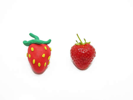 Comparison of two strawberries - Real and Fake.