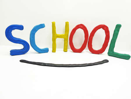 The word school made from plasticine. Colored abstraction.
