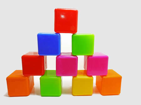 Pyramid built from colored childrens blocks. Isolated on white background. Stock Photo