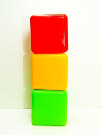 rules: Colorful traffic light made from children cubic blocks on white background Stock Photo