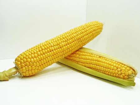 Fresh yellow corn isolated on white background.