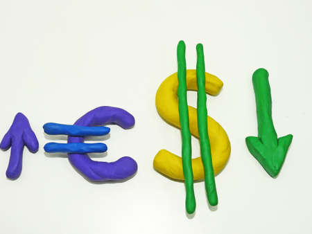 Currency signs made from plasticine. Abstraction on a white background. Stock Photo