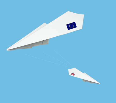 dilema: Plane made from paper with flag. Isolated on blue background. Stock Photo