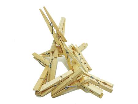 Wooden clothespin isolated on white background. Macro photo. Stock Photo