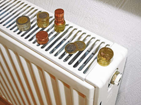 Money for utility bills on white battery