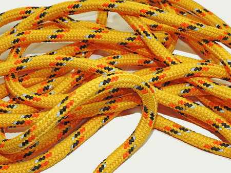 nodes: Yellow rope with some nodes. Isolated on white background