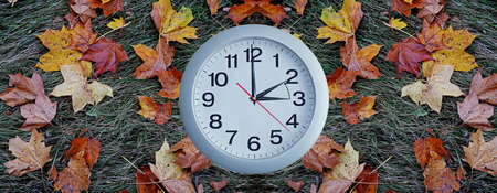 back in an hour: Daylight Saving Time. Wall Clock going to winter time