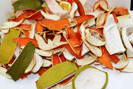 Dried orange and citrus peel. Isolated on white background.