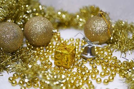 Golden Christmas decoration. Isolated on white background. Stock Photo