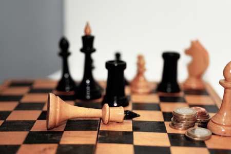 traitor: Abstract composition of chess figures. Isolated on white background.