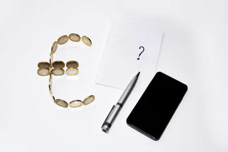 card making: Euro symbol builds from coins with pen on white background Stock Photo