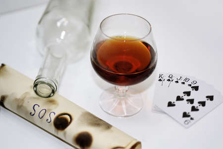 venganza: Abstract composition of drinking and playing cards. Isolated on white background.