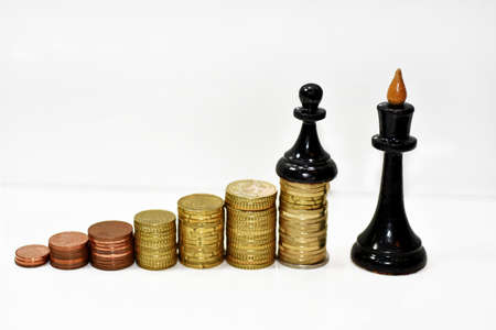 Abstract composition of chess and money. Isolated on white background.