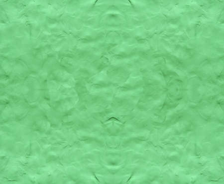 Green background with fingerprints made from plasticine.