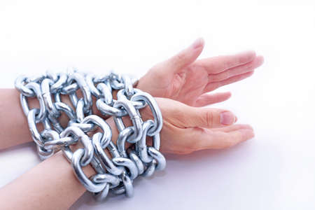 Abstract composition with hands and metal chain.