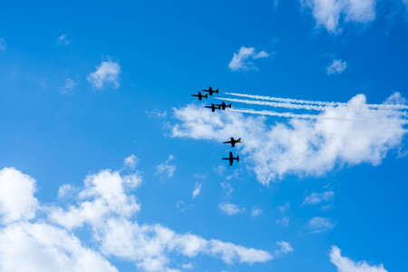 Six planes on summer sunny sky with white clouds