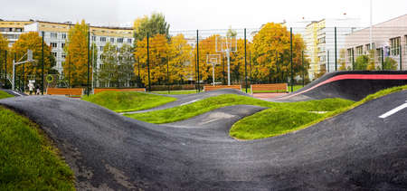 Bicycle track road. Located in city playground.