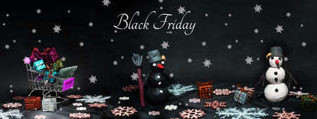 Black Friday abstract photo. Happy Merry Christmas. Snowman made from plasticine on black background.