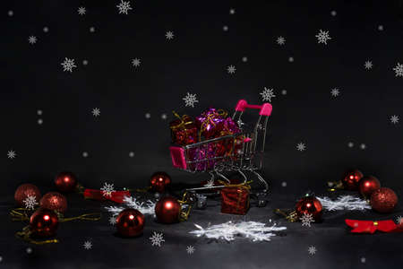 Black Friday abstract photo. Happy Merry Christmas. Shopping cart with decorative presents. Stock Photo - 90322958