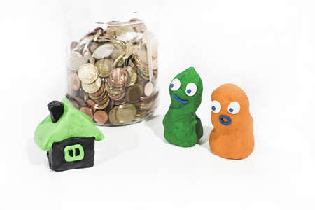 Abstract persons made from Play Clay. Property price and credit abstraction. Stock Photo