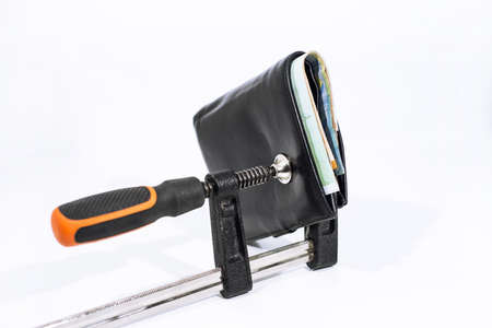 Abstract photo. Purse under clamp. Isolated on white background.