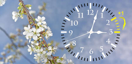 Daylight Saving Time. DST. Wall Clock going to winter time. Turn time forward. Abstract photo of changing time at spring. Banco de Imagens