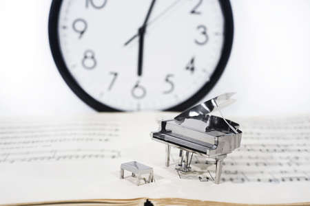 Abstract photo of music. Small metal piano with notes book. Piano Jazz music.