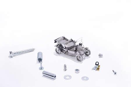 Abstract composition of broken car and repair process. Archivio Fotografico
