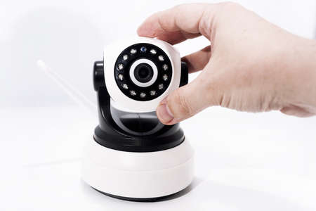 Spy video camera isolated on white background. Abstract surveillance idea through web camera.