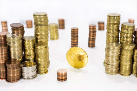 Abstract photo of cryptocyrrency. Some big crypto currency coins with euro coins. Isolated on white background. Stock Photo