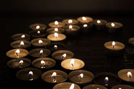 Symbols of Islam. Candle lights on black background. Abstract isolated photo.