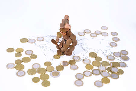 A lot of coins on World Map. Abstract photo of world economy.