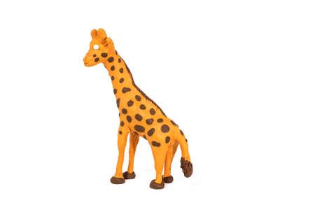 Plasticine artwork Handmade giraffe. Abstract isolated photo.