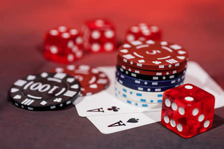 Casino abstract photo. Poker game on red background. Theme of gambling. Stock Photo