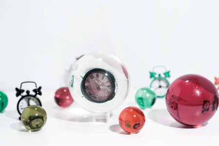 Time abstraction. Glass balls with clock reflections. Stock Photo