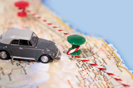 Abstract idea of rent a car. Small car on map. Abstract travel photo.