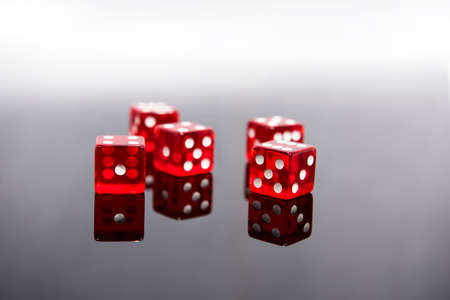 Red dice on transparent black background
