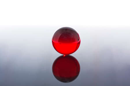 Glass ball in red. Crystal ball in abstract red. Magic ball. Zdjęcie Seryjne