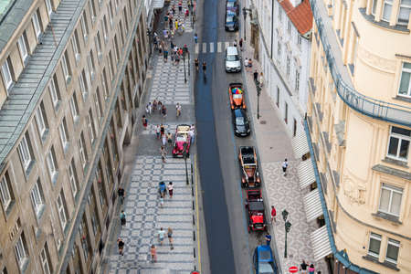 Prague, Czech Republic - June 15, 2019: Prague Street With People And Retro Cars In Old City. Publikacyjne