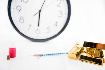 Medicine documents with clock and golden bars. Abstract photo of illness time.