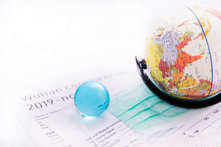 Medicine documents with small globe on it. Abstract photo of illness time.