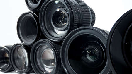 Collection of camera lens isolated on white background. Foto de archivo