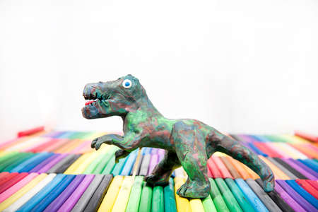 Play clay Animals. Dinosaur on colored background.