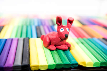 Play clay Animals. Red Hare on colored background. Stock fotó