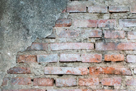 dirt: cracked concrete vintage brick wall background Stock Photo