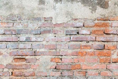 cracked concrete vintage brick wall background Stock Photo