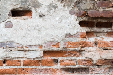 revetment: cracked concrete vintage brick wall background Stock Photo