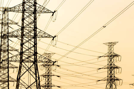 metal grid: silhouette of high voltage electrical pole structure Stock Photo