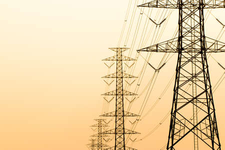 electric grid: silhouette of high voltage electrical pole structure Stock Photo