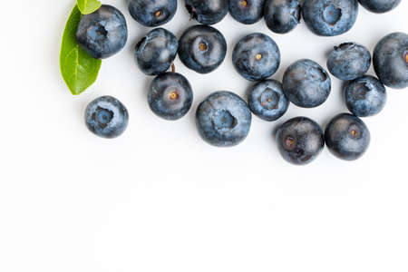 Blueberry. Two fresh blueberries with leaves isolated on white background. With clipping path. Archivio Fotografico
